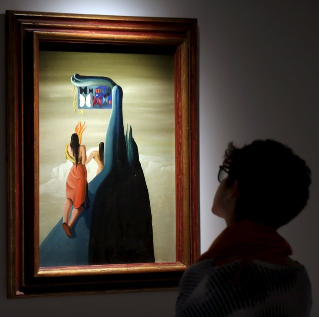 """A visitor views the painting """"Butterflies Lost in the Mountains"""" by Spanish artist Oscar Dominguez at the """"Picasso and the Spanish Modernity"""" exhibition at Centro Cultural Banco do Brazil in Sao Paulo March 25, 2015. (Photo by Paulo Whitaker/Reuters)"""