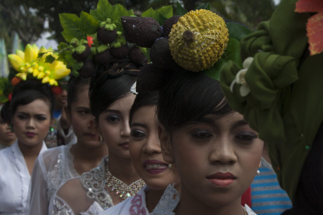 Girls march during festival durian at northern slopes of Mount Arjuna in East Java. (Photo by Sigit Pamungkas/JG Photo)