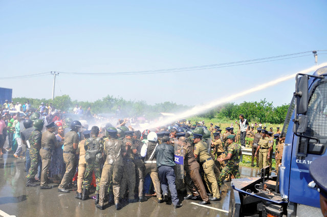 Police clash with demonstrators during a protest against the launching of a Chinese industrial zone by China Merchants Port Holdings Company, in Mirijjawila, Sri Lanka January 7, 2017. (Photo by Reuters/Stringer)