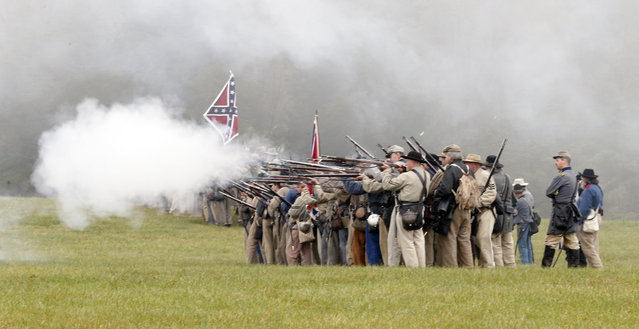 Confederate troops fire on Union troops during a re-enactment of the Battle of Appomattox Courthouse as part of  commemoration of the 150th anniversary of the surrender of the Army of Northern Virginia at Appomattox Court House in Appomattox, Va., Thursday, April 9, 2015. (Photo by Steve Helber/AP Photo)