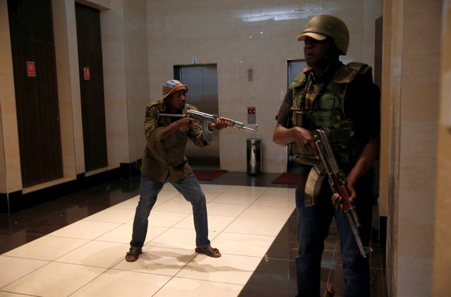 Members of security forces secure a building at the scene where explosions and gunshots were heard at the Dusit hotel compound, in Nairobi, Kenya on January 15, 2019. (Photo by Baz Ratner/Reuters)