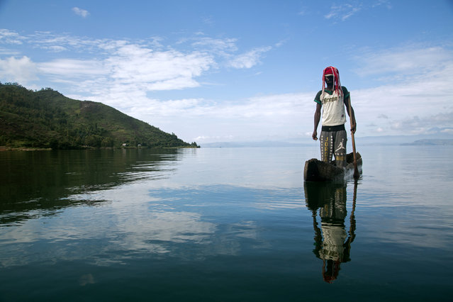 Manguiste, 24, stands in a canoe on Lake Kivu just off Idjwi island in the Democratic Republic of Congo,  November 26, 2016. (Photo by Therese Di Campo/Reuters)