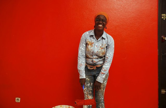 Ange Dede, a 29-year-old painter and decorator poses for a photograph in Abidjan, Ivory Coast, March 2, 2016. Women have long played a dominant role in agriculture in Ivory Coast and in the sprawling markets where most Ivorians purchase their daily necessities. Now some are breaking through into the most important positions in government, administration and business – positions long held by males in this traditional society. Ivorian women today work in a range of jobs – from gas-station attendant to plastic recycler and lawyer. International Women's Day is marked on March 8. (Photo by Thierry Gouegnon/Reuters)