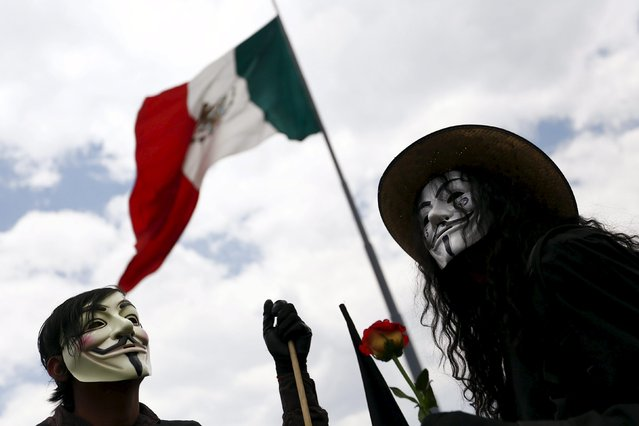 Protesters wearing Guy Fawkes masks take part in a march for Labor Day in Mexico City May 1, 2015. (Photo by Edgard Garrido/Reuters)