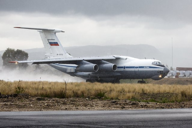 A Russian Ilyushin Il-76 military transport aircraft is seen on a runway shortly before taking off, part of the withdrawal of Russian troops from Syria, at Hmeymim airbase, Syria, March 16, 2016. (Photo by Vadim Grishankin/Reuters/Russian Ministry of Defence)