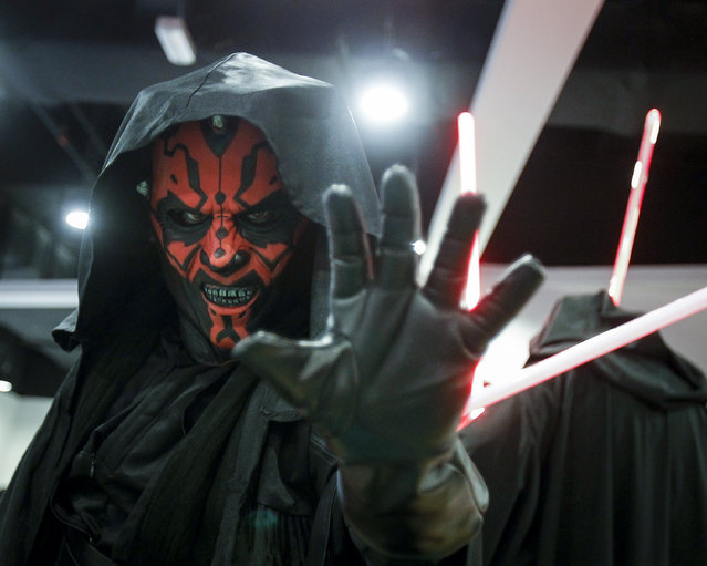 A Star Wars fan dressed as Darth Maul poses for photograph at a Star Wars Day gathering in a mall downtown Kuala Lumpur, Malaysia, Saturday, May 2, 2015. (Photo by Joshua Paul/AP Photo)