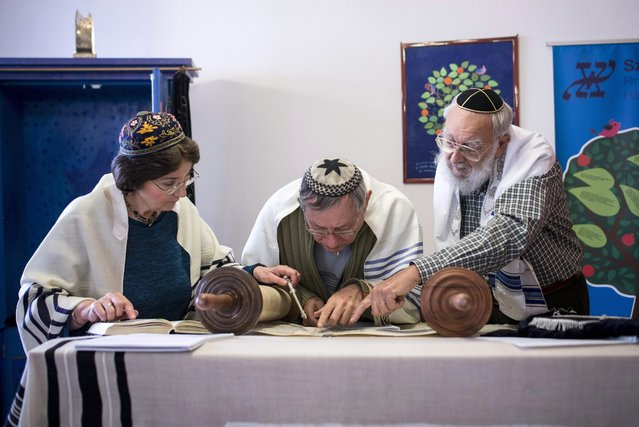 Hungary's only female rabbi Katalin Kelemen (L) reads the Torah with two other rabbis during a Shabbath service in the synagogue of the Sim Shalom Progressive Jewish Congregation in central Budapest, Hungary, 05 March 2016. (Photo by Bea Kallos/EPA)