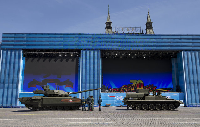 Russian army officers speak a crew member of new a Russian T-14 Armata tank at the Red Square during a preparation for general rehearsal for the Victory Day military parade which will take place at Moscow's Red Square on May 9 to celebrate 70 years after the victory in WWII, in Moscow, Russia, Thursday, May 7, 2015. (Photo by Alexander Zemlianichenko/AP Photo)