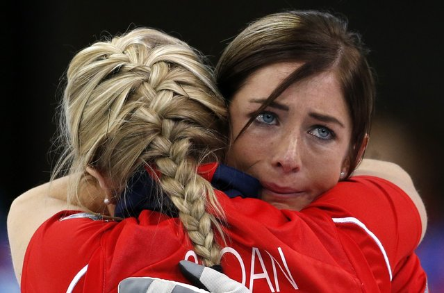 Britain's skip Eve Muirhead, right, embraces Anna Sloan after defeating Switzerland to win the women's curling bronze medal at the 2014 Winter Olympics, Thursday, February 20, 2014, in Sochi, Russia. (Photo by Robert F. Bukaty/AP Photo)