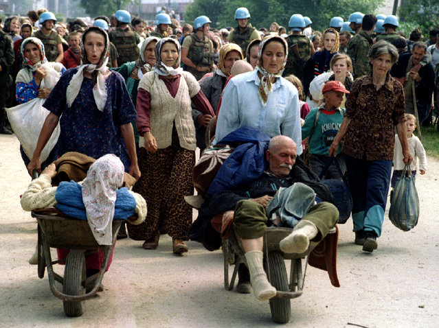 A group of Muslim refugees from Srebrenica walk to be transported from the eastern Bosnian village of Potocari, July 1995. (Photo by Reuters)