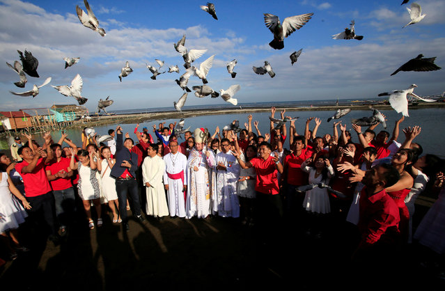 Newly-wed couples release pigeons after their mass wedding as part of Valentine's Day celebration in Rosario town, Cavite city, south of Manila, Philippines February 14, 2017. (Photo by Romeo Ranoco/Reuters)