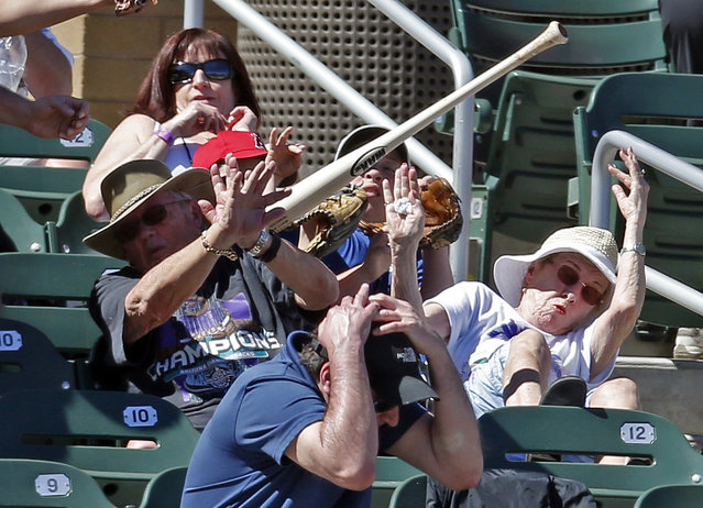 Fans try to get out of the way after San Francisco Giants third baseman Matt Duffy lost his bat in the third inning during a spring training game against the Arizona Diamondbacks at Salt River Fields in Arizona, March 23, 2016. (Photo by Rick Scuteri/Reuters/USA Today Sports)