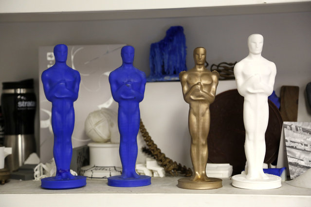 Different 3-D printed versions of the Oscar statuette are displayed at the Polich Tallix Fine Art Foundry in Rock Tavern, N.Y., Thursday, January 12, 2017. (Photo by Seth Wenig/AP Photo)