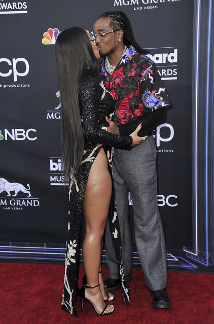 Saweetie, left, and Quavo kiss as they arrive at the Billboard Music Awards on Wednesday, May 1, 2019, at the MGM Grand Garden Arena in Las Vegas. (Photo by Richard Shotwell/Invision/AP Photo)
