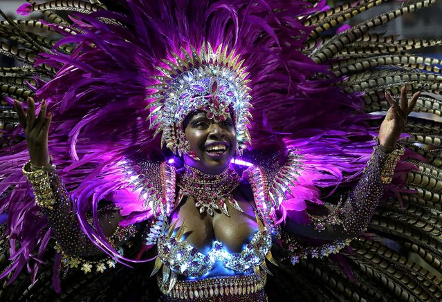 A dancer from the Nene de Vila Matilde samba school performs during a Carnival parade in Sao Paulo, March 2. (Photo by Andre Penner/Associated Press)