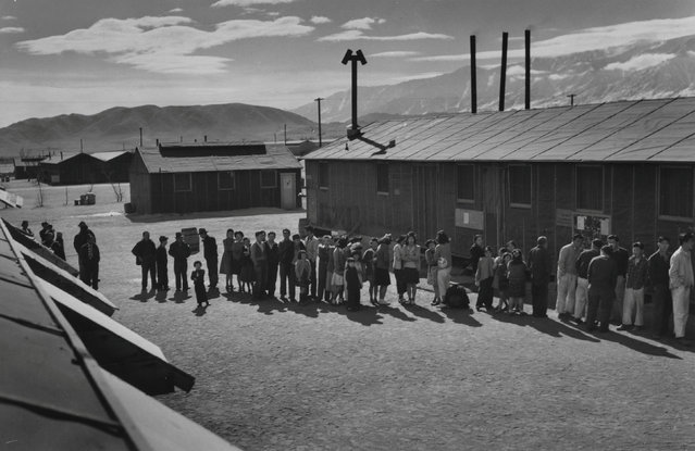 A mess line is formed in front of a building at midday at the Manzanar War Relocation Center in California, in this 1943 handout photo. (Photo by Courtesy Ansel Adams/Library of Congress, Prints and Photographs Division/Reuters)