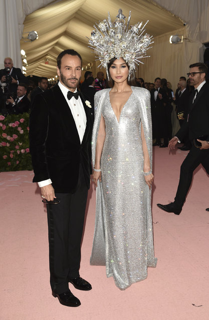 "Tom Ford, left, and Gemma Chan attend The Metropolitan Museum of Art's Costume Institute benefit gala celebrating the opening of the ""Camp: Notes on Fashion"" exhibition on Monday, May 6, 2019, in New York. (Photo by Evan Agostini/Invision/AP Photo)"