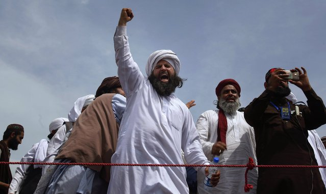 A protestesr from Pakistan's Sunni Tehreek group chants slogans during a sit-in near the parliament building in Islamabad, Pakistan, Tuesday, March 29, 2016. Hundreds of Islamic extremists who earlier violently protested in Islamabad over the hanging of a man who killed a secular governor continued their demonstrations in Pakistan's capital on Tuesday, bringing the most sensitive parts of the capital to a standstill. (Photo by Anjum Naveed/AP Photo)