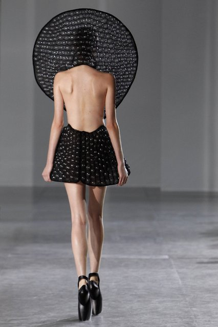 A model wears a creation as part of Iris Van Herpen's ready-to-wear fall/winter 2014-2015 fashion collection presented in Paris, Tuesday, March 4, 2014. (Photo by Thibault Camus/AP Photo)