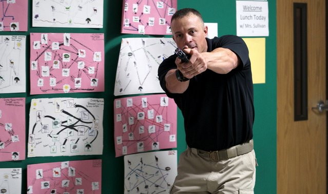 Joe Deedon, president of TAC ONE Consulting, demonstrates searching for a shooter in a middle school during an Active Shooter Response course offered by TAC ONE in Denver April 2, 2016. (Photo by Rick Wilking/Reuters)