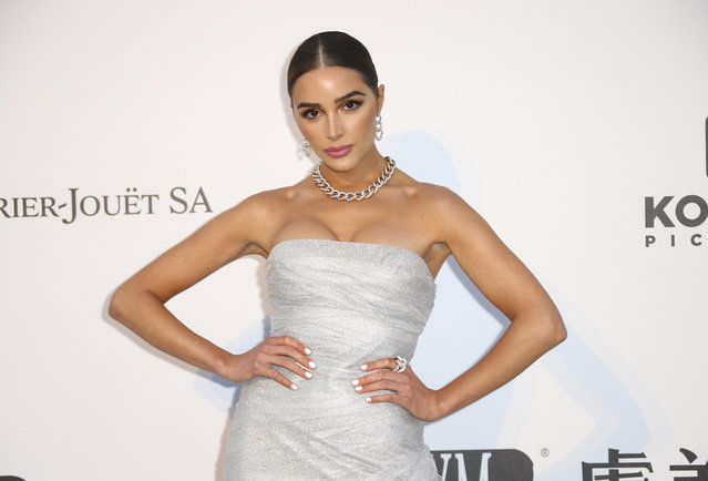 Model Olivia Culpo poses for photographers upon arrival at the amfAR, Cinema Against AIDS, benefit at the Hotel du Cap-Eden-Roc, during the 72nd international Cannes film festival, in Cap d'Antibes, southern France, Thursday, May 23, 2019. (Photo by Joel C. Ryan/Invision/AP Photo)