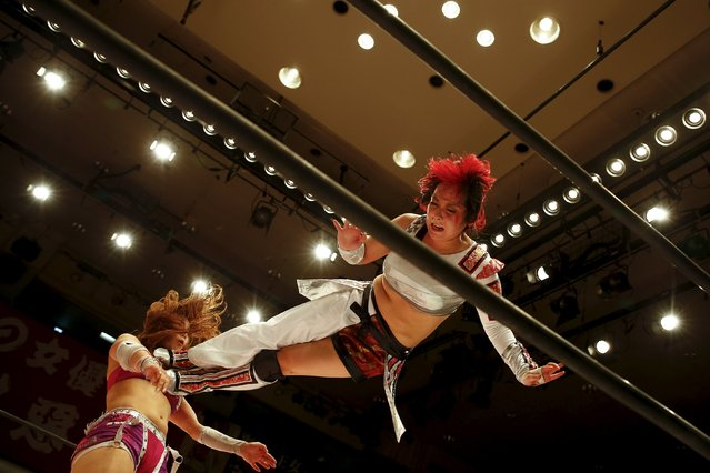 Wrestler Act Yasukawa (R), jumps at Kairi Hojo during their Stardom female professional wrestling show at Korakuen Hall in Tokyo, Japan, December 23, 2015. (Photo by Thomas Peter/Reuters)