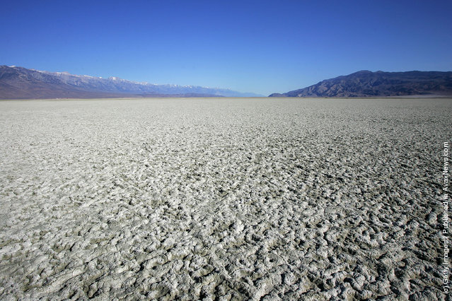 A salty crust of fine dust covers the mostly-dry Owens Lake bed
