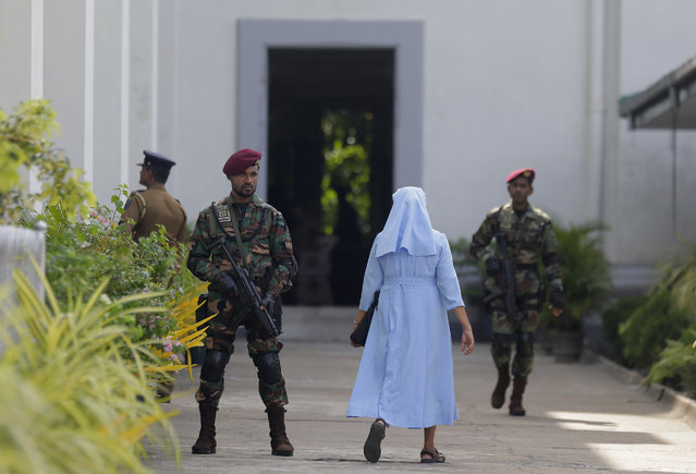 Sri Lankan army commando soldiers secure the St. Lucia's Cathedral during a holy mass held to bless the victims of Easter Sunday attacks in Colombo, Sri Lanka, Saturday, May 11, 2019. In the two Sundays that followed Easter, most churches were closed with armed guards. (Photo by Eranga Jayawardena/AP Photo)