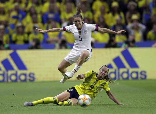 United States' Kelley O Hara leaps over Sweden's Kosovare Asllani during the Women's World Cup Group F soccer match between Sweden and the United States at Stade Océane, in Le Havre, France, Thursday, June 20, 2019. (Photo by Alessandra Tarantino/AP Photo)