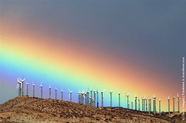 The first storm of the season produces a rainbow behind wind turbines in the San Gorgonio Pass