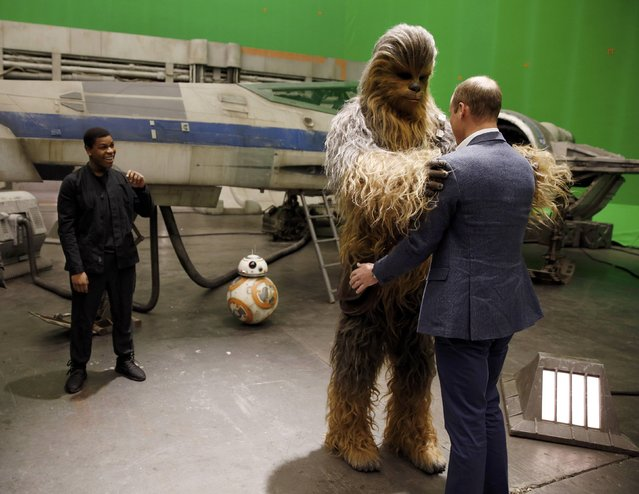Britain's Prince William is hugged by Chewbacca as British actor John Boyega smiles during a tour of the Star Wars sets at Pinewood studios in Iver Heath, west of London, Britain on April 19, 2016. (Photo by Adrian Dennis/Reuters)
