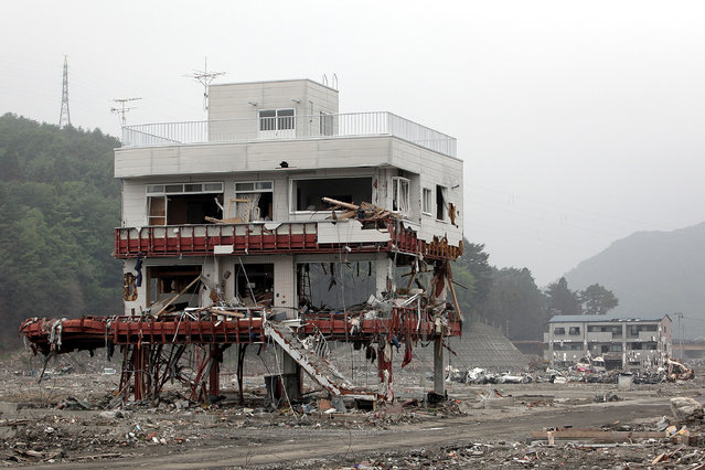 The remaining destroyed buildings stand in the tsunami-hit area on June 12, 2011 in Otsuchi, Iwate, Japan. Japanese government has been struggling to deal with the earthquake and tsunami as well as the troubled Fukushima Daiichi Nuclear Power Plant. The fear of infectious disease outbreak  is mounting due to the humid rainy season and delay of the debris clearing.  (Photo by Kiyoshi Ota/Getty Images)