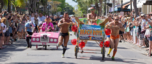 """Competitors in the Conch Republic Bed Race roll up Duval Street in Key West, Florida April 30, 2016. The event, billed as the most fun you can have in bed with your clothes on, was a facet of the island city's annual Conch Republic Independence Celebration that commemorates a 1982 """"secession"""" from the United States after the U.S. Border Patrol established a checkpoint at the top of the Florida Keys Overseas Highway. (Photo by Rob O'Neal/Reuters/Courtesy of Florida Keys News Bureau)"""