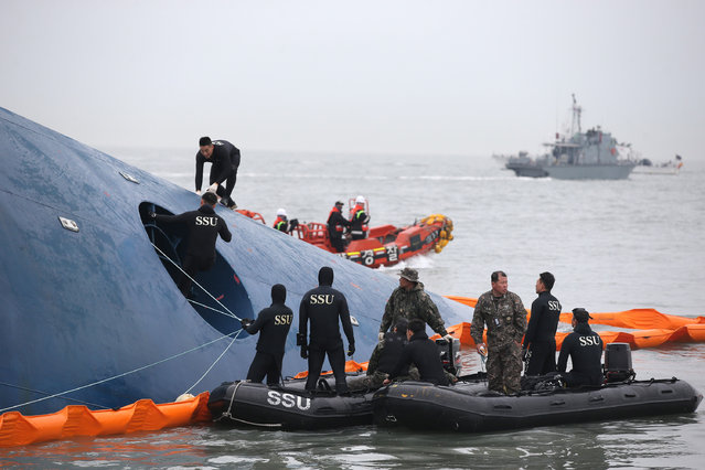 South Korean rescue team members search for passengers aboard a ferry sinking off South Korea's southern coast, in the water off the southern coast near Jindo, south of Seoul, South Korea, Thursday, April 17, 2014. Fears rose Thursday for the fate of more than 280 passengers still missing more than 24 hours after their ferry flipped onto its side and filled with water off the southern coast of South Korea. (Photo by AP Photo/Yonhap)