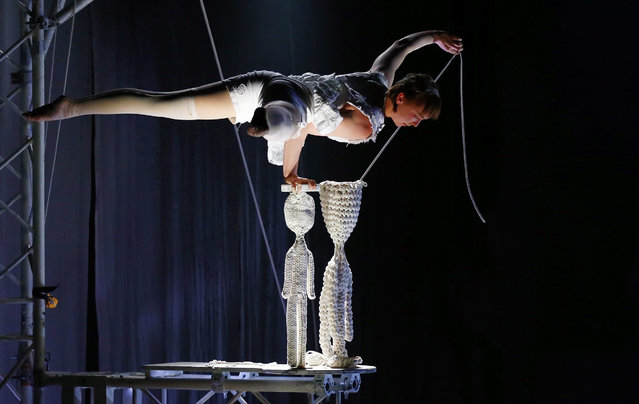 "A member of the Swedish circus company Cirkus Cirkor performs during their show ""Knitting Peace"", at Las Condes Municipal Theater in Santiago, Chile, 30 June 2015. The circus will be performing in Chile from 01 to 12 July. (Photo by Javier Valdes/EPA)"