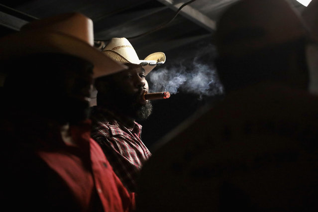 Cowboys relax at a late-night barbeque following a day of competition at the Bill Pickett Invitational Rodeo on April 1, 2017 in Memphis, Tennessee. (Photo by Scott Olson/Getty Images)