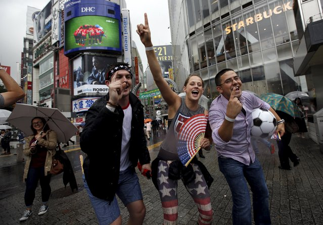 U.S. residents in Japan celebrate their country's victory after their Women's World Cup final soccer match against Japan in Vancouver, at Tokyo's Shibuya shopping and amusement district, Japan, July 6, 2015. The United States ushered in a new era of dominance with their Women's World Cup triumph on Sunday, a victory that will do plenty to bring an already passionate American interest in the sport to unprecedented levels. (Photo by Issei Kato/Reuters)