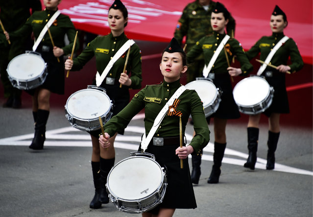 A military band playing during the Immortal Regiment march in Vladivostok, Russia on May 9, 2016. (Photo by Yuri Smityuk/TASS/Getty Images)