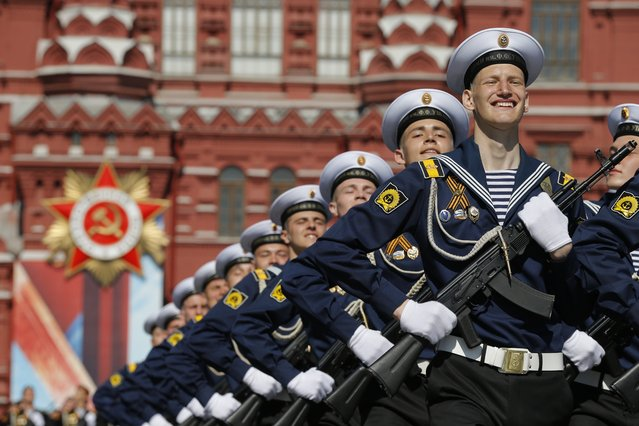 Russian soldiers march during the Victory Day military parade marking 71 years after the victory in WWII in Red Square in Moscow, Russia, Monday, May 9, 2016. (Photo by Alexander Zemlianichenko/AP Photo)