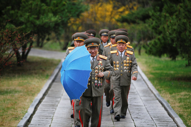 Military officers visit the birthplace of North Korean founder Kim Il Sung, a day before the 105th anniversary of his birth, in Mangyongdae, just outside Pyongyang, North Korea April 14, 2017. (Photo by Damir Sagolj/Reuters)