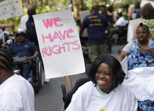 Lolita Thompson smiles as she lines up to participate in the inaugural Disability Pride Parade in New York, Sunday, July 12, 2015. (Photo by Seth Wenig/AP Photo)