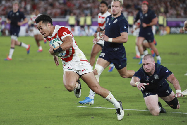 Kenki Fukuoka (11) of Japan tries in the first half of the Rugby World Cup Pool A match against Scotland at International Stadium Yokohama in Yokohama City, Kanagawa Prefecture on October 13, 2019. (Photo by The Yomiuri Shimbun via AP Images)