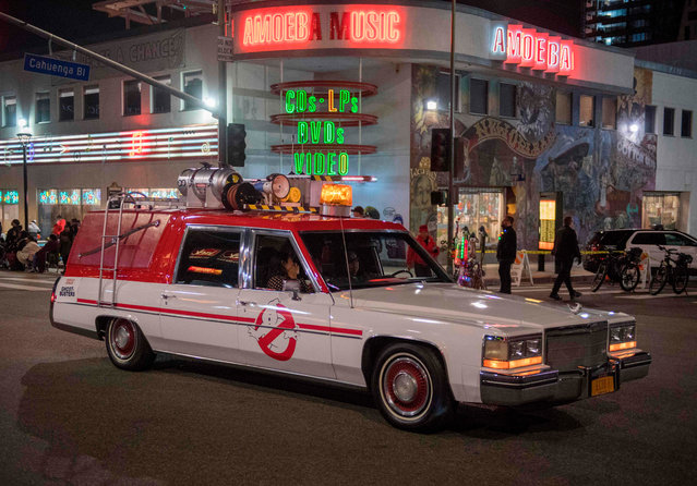"""The """"Ghostbusters"""" movie car is driven down Sunset Blvd during the 88th annual Hollywood Christmas Parade in Hollywood, California on December 1, 2019. (Photo by Mark Ralston/AFP Photo)"""