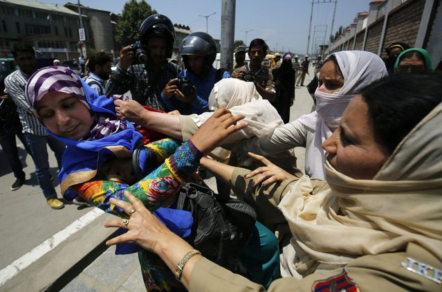 Indian Policewomen detains an employee of All J&K Saakshar Bharat Mission (SBM) Coordinators Forum outside the Jammu and Kashmir Assembly in Srinagar, the summer capital of Indian Kashmir, 06 June 2016. Police detained half a dozen of these employees when they were trying to cordon the Legislative Assembly during its session. They were demanding the release of their wages for the past three to four years and regularisation of their services. (Photo by Farooq Khan/EPA)