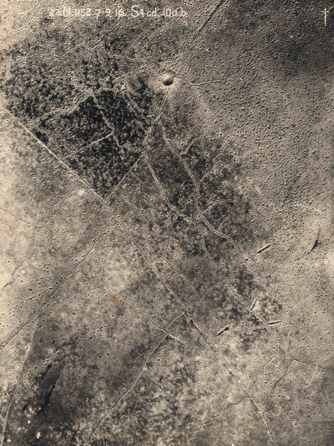 An aerial photograph taken from a British aeroplane shows a view of trenches with a giant crater and shell damage marking the land between the trenches on the Western Front, in this September 7, 1916 handout picture. This picture is part of a previously unpublished set of World War One (WWI) images from a private collection. The pictures offer an unusual view of varied and contrasting aspects of the conflict, from high tech artillery to mobile pigeon lofts, and from officers partying in their headquarters to the grim reality of life and death in the trenches. The year 2014 marks the centenary of the start of the war. (Photo by Reuters/Archive of Modern Conflict London)