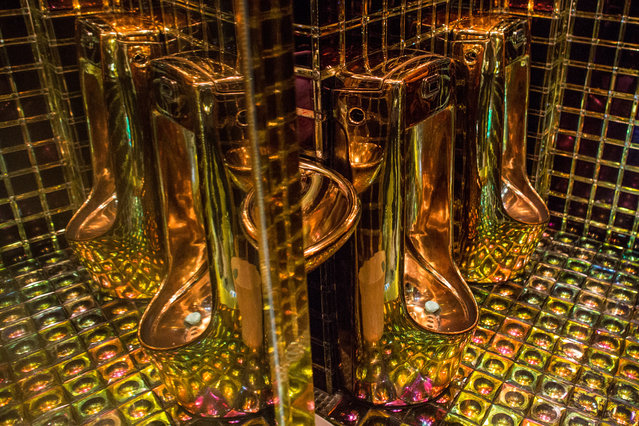 Gold coloured urinals are seen in the men's bathroom  at The Robot Restaurant on June 29, 2014 in Tokyo, Japan. The now famous Robot Restaurant opened two years ago in Kabukicho area of Shinjuku at an estimated cost of 10 million U.S. dollars. (Photo by Chris McGrath/Getty Images)