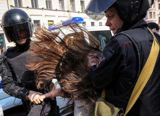 Police officers detain an opposition protester during a May Day rally in Saint Petersburg, Russia on May 1, 2019. (Photo by Igor Russak/Reuters)