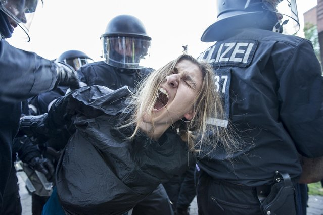 """Protesters clash with Police during the demonstration """"Welcome to Hell"""" at the Fish Market (fischmarkt) ahead of the G20 summit in Hamburg, Germany, 06 July 2017. The G20 Summit (or G-20 or Group of Twenty) is an international forum for governments from 20 major economies. The summit is taking place in Hamburg from 07 to 08 July 2017. (Photo by Cover Images)"""