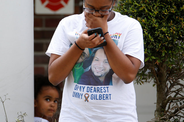 A girl watches a woman cry outside the funeral for Peter Gonzalez-Cruz and Gilberto Ramon Silva,  both victims of the shooting at Pulse night club in Orlando, Florida, U.S., June 17, 2016. (Photo by Carlo Allegri/Reuters)