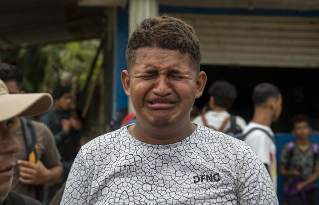 A teenage Honduran migrant traveling in a group of migrants cries as is he deported by Guatemalan police in Morales, Guatemala, Thursday, January 16, 2020. (Photo by Moises Castillo/AP Photo)